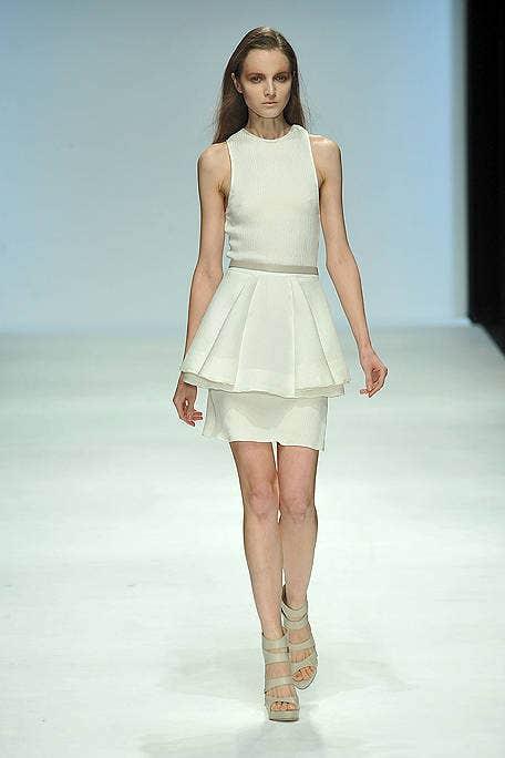 Clothing, Skin, Human leg, Shoulder, Dress, Joint, Fashion show, White, Fashion model, Style,