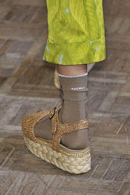 Human leg, Fashion, Beige, Tan, Fawn, Sandal, Foot, Ankle, Natural material, Fashion design,