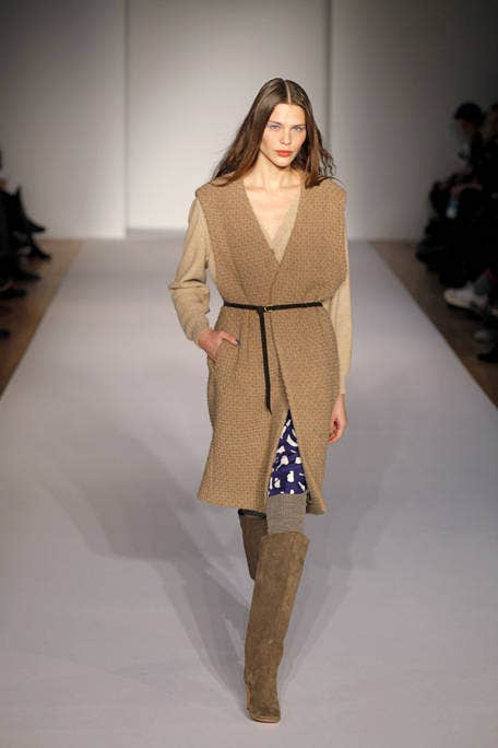 Brown, Sleeve, Shoulder, Fashion show, Joint, Outerwear, Khaki, Style, Runway, Fashion model,