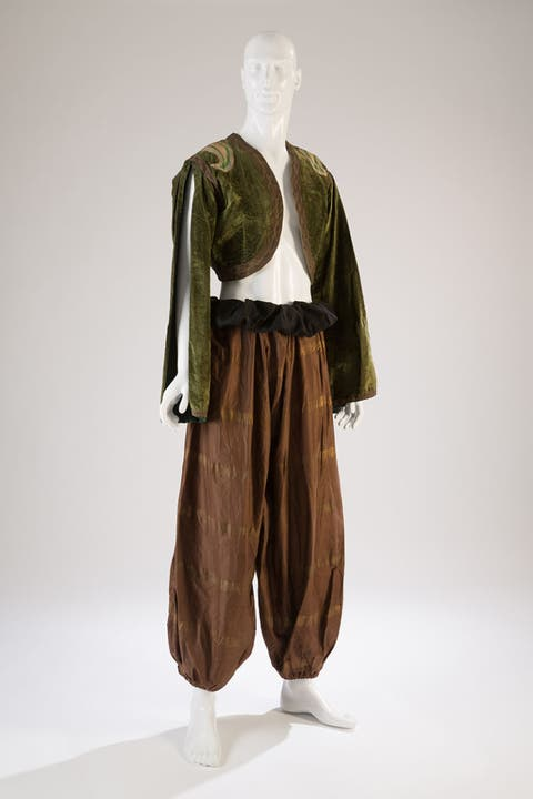 Brown, Sleeve, Human body, Standing, Khaki, Joint, Collar, Sculpture, Costume design, Toy,