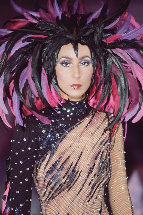 cher in a feathered headpiece in 1972