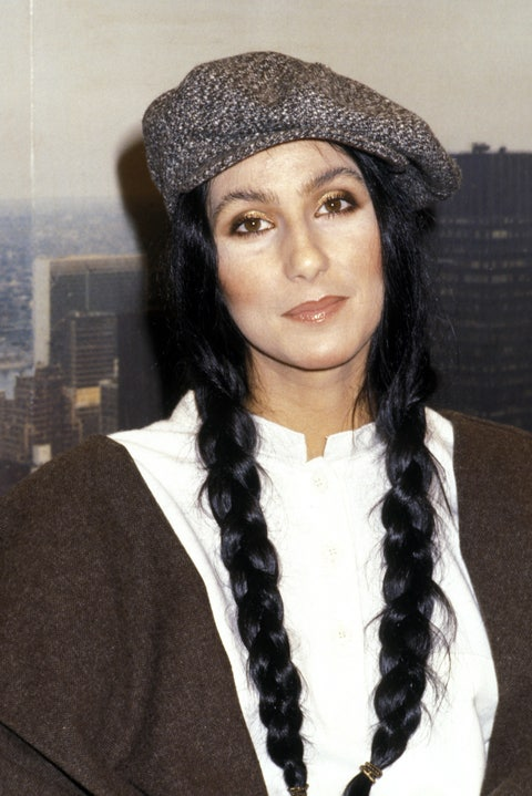 cher with hair in braided pigtails