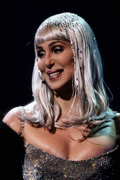 cher at the 1999 brit awards in a silver wig