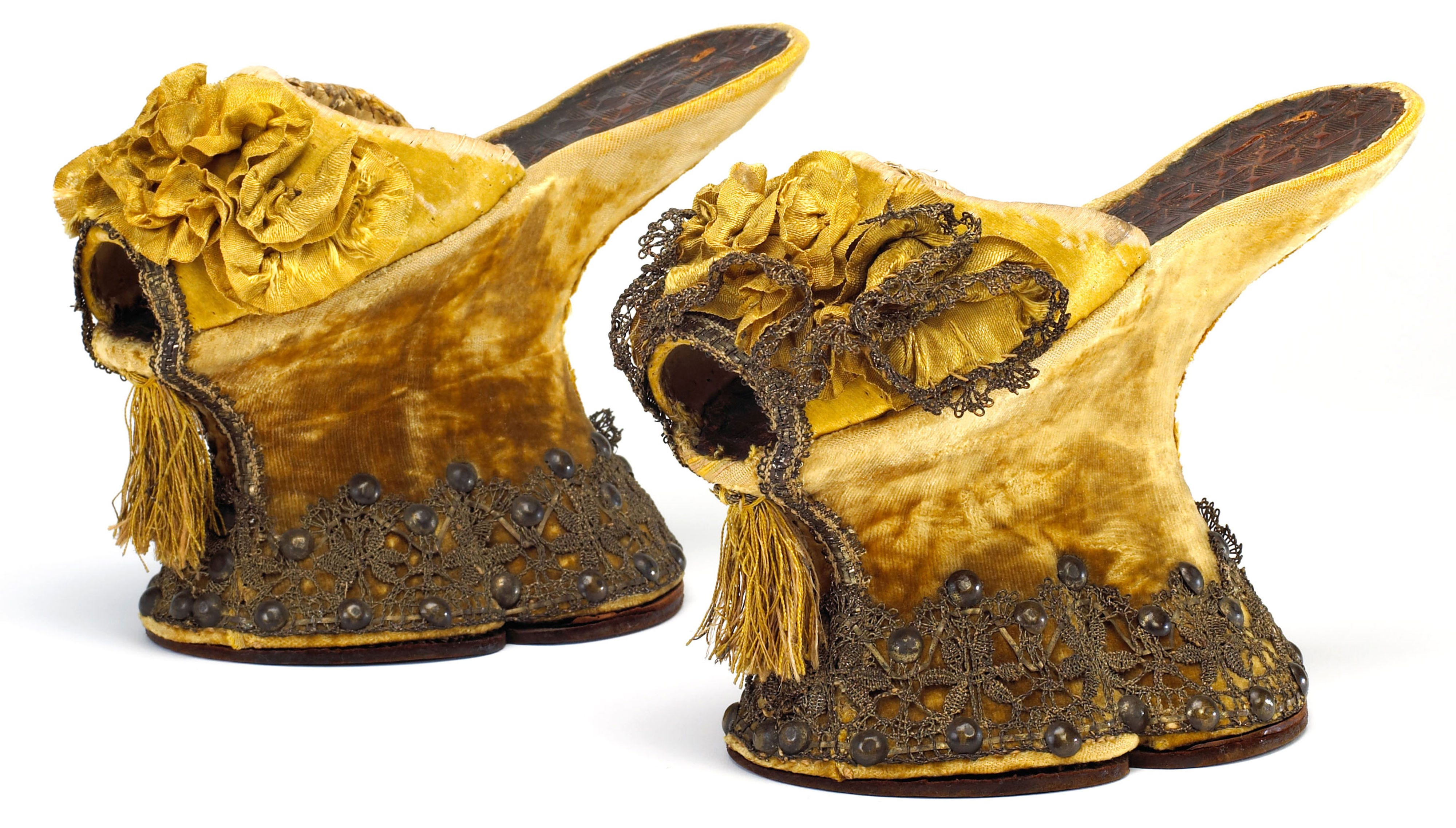 <p>The earliest instances of heeled shoes date back as far as the Egyptians, but the look really picked up steam during the 16th Century. Towering platforms called 'chopines' are thought to have originated with prostitutes in Venice for the added sex appeal the extra height offered, but soon became popular amongst aristocrats for their ability to keep clothes from dragging in the filth that covered the streets. </p>