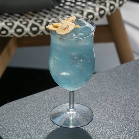 Drink, Alcoholic beverage, Table, Distilled beverage, Non-alcoholic beverage, Cocktail, Glass, Stemware, Classic cocktail, Food,