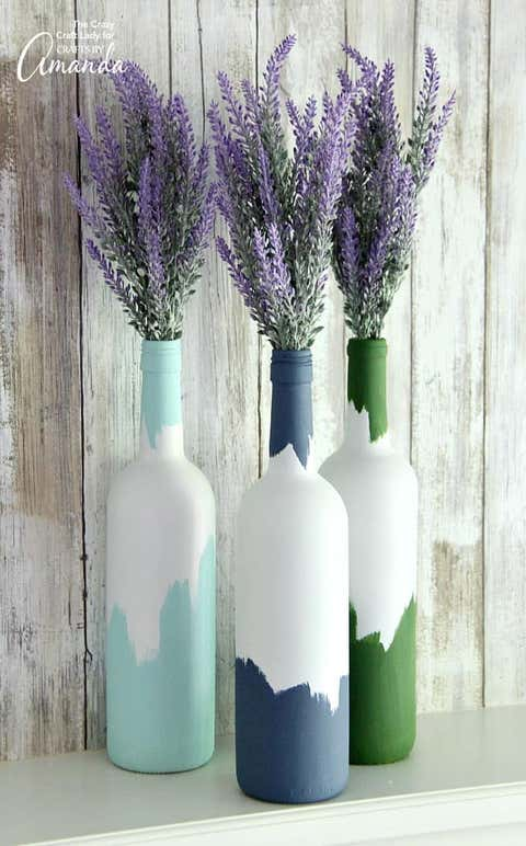 abstract painted wine bottle centerpieces