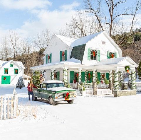 white farmhouse exterior with garland
