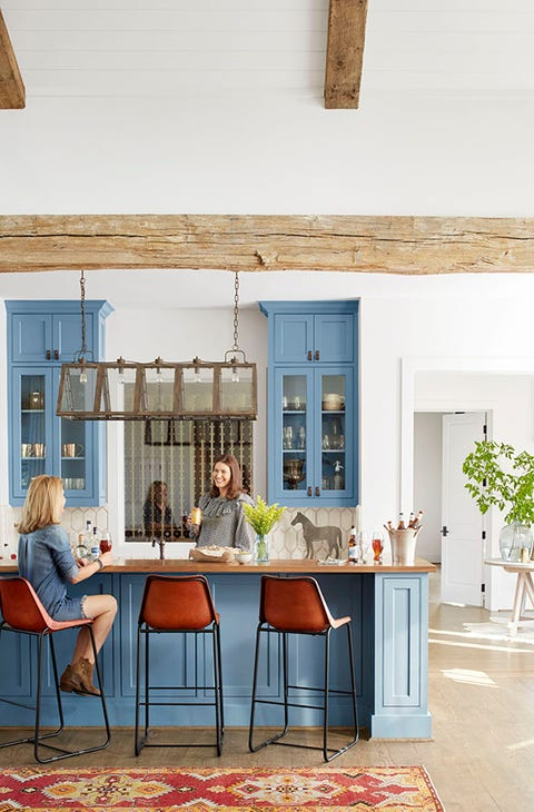 farmhouse kitchen in bellville, texas with cornflower blue cabinets