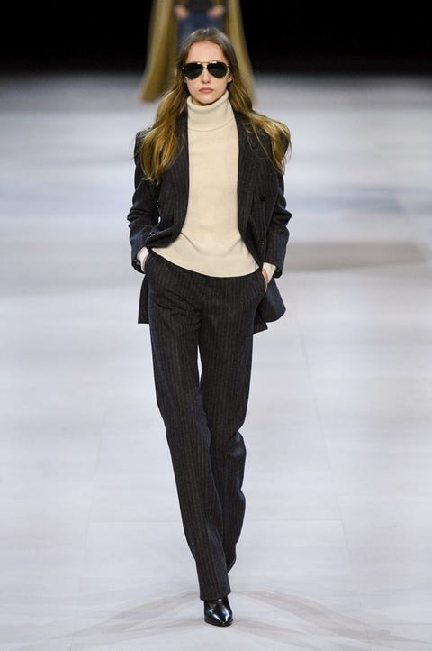 Fashion model, Fashion show, Fashion, Runway, Clothing, Shoulder, Eyewear, Waist, Outerwear, Human,