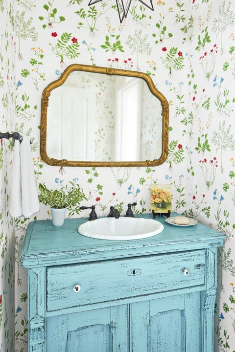 cheery powder room with floral wallpaper