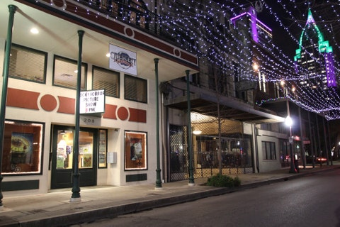 Lighting, Electricity, Night, Retail, Midnight, Sidewalk, Signage, Light fixture, Christmas decoration, Commercial building,