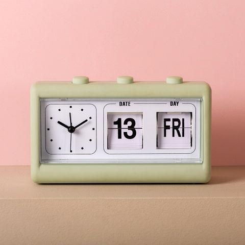 retro alarm clock on pink background