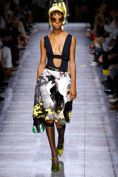 Fashion model, Fashion show, Runway, Fashion, Clothing, Yellow, Dress, Fashion design, Haute couture, Shoulder,