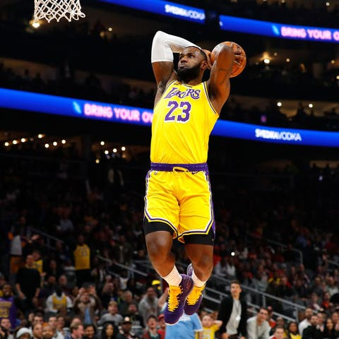 atlanta, georgia   december 15  lebron james 23 of the los angeles lakers dunks against the atlanta hawks in the first half at state farm arena on december 15, 2019 in atlanta, georgia  note to user user expressly acknowledges and agrees that, by downloading andor using this photograph, user is consenting to the terms and conditions of the getty images license agreement  photo by kevin c coxgetty images