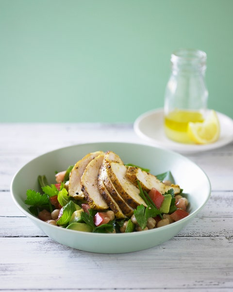 bowl of chicken on top of chickpeas