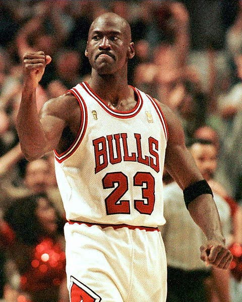 chicago, united states  michael jordan of the chicago bulls pumps his fist after scoring the game winning  basket in the fourth quarter 01 june during game one of the nba finals at the united center in chicago, il  the bulls defeated the utah jazz 84 82     afp photo vincent laforet photo credit should read vincent laforetafp via getty images