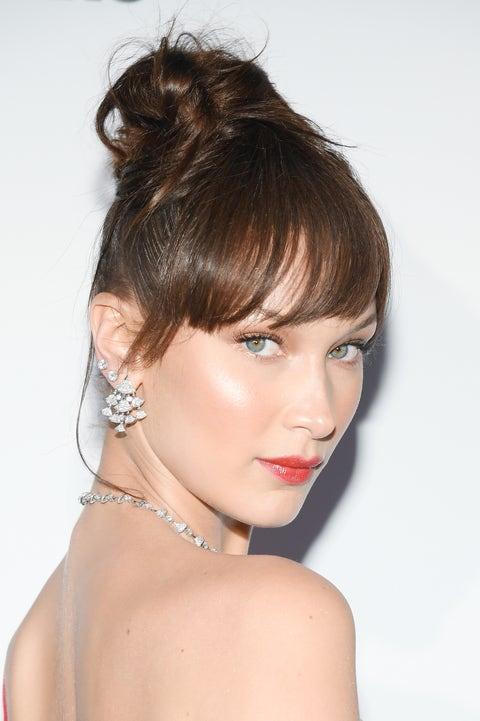 Ear, Lip, Hairstyle, Skin, Chin, Shoulder, Earrings, Eyelash, Style, Strapless dress,