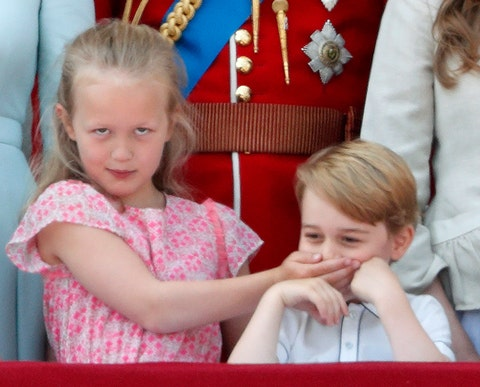 london, united kingdom june 09 embargoed for publication in uk newspapers until 24 hours after create date and time savannah phillips puts her hand over prince george of cambridges mouth as they stand on the balcony of buckingham palace during trooping the color 2018 on june 9, 2018 in london, england the annual ceremony, involving over 1400 guardsmen and cavalry, is believed to have first been performed during the reign of king charles ii the parade marks the official birthday of the sovereign, even though the queens actual birthday is on april 21st photo by max mumbyindigogetty images