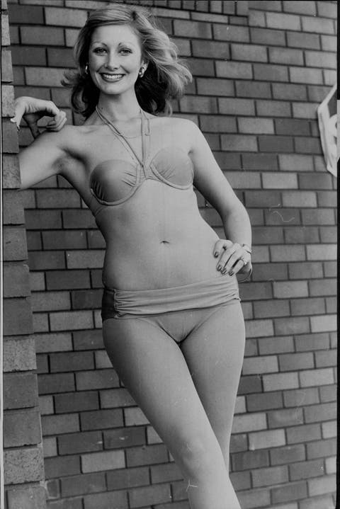 """Kathy wearing the new look in pink bikinis, at the """"Sun' Glimmer Parade.Taking advantage of Sydney's above average temperatures was Kathy Wilding, 22 of Double Bay who was appearing in a Fashion Parade at Grace Bros. Roselands. Between parade Kathy sunbat"""