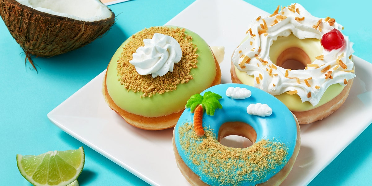 Krispy Kreme's New Piña Colada Donut Is Complete With Toasted Coconut and a Candied Cherry