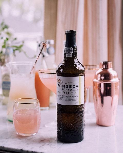 Bottle, Glass bottle, Pink, Drink, Wine bottle, Peach, Distilled beverage, Centrepiece, Glass, Wine,