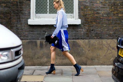 Clothing, Footwear, Human leg, Automotive exterior, T-shirt, Street fashion, Shorts, Knee, Bumper, Electric blue,