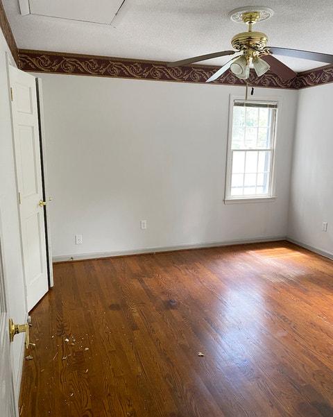 empty bedroom with wood floor