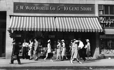 People walk past Woolworth Store