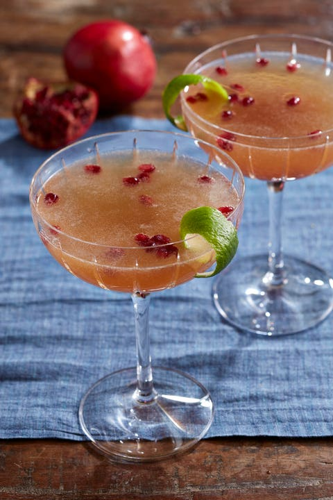 pomegranate french 75 cocktail in a champagne coupe