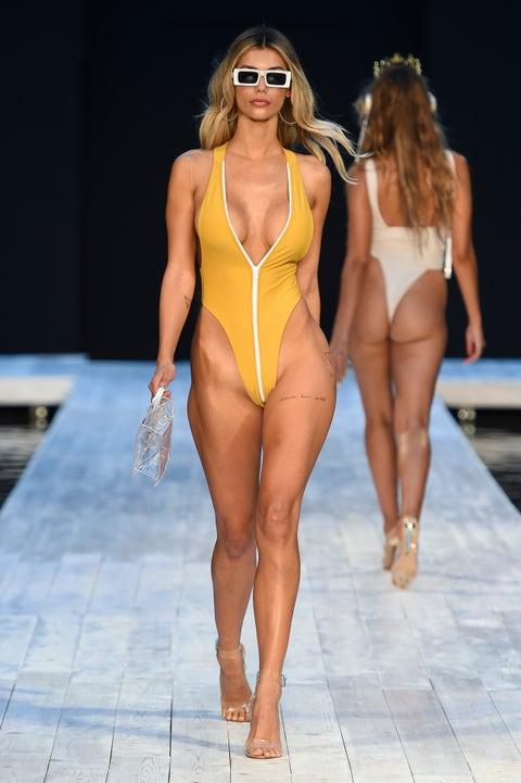 Fashion model, Fashion show, Fashion, Clothing, Human leg, Bikini, Runway, Thigh, Monokini, Swimwear,