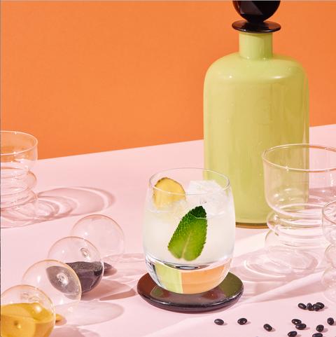 Drink, Liqueur, Cocktail garnish, Lime, Alcoholic beverage, Distilled beverage, Paloma, Food, Still life, Citrus,