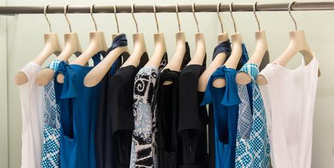 Clothes hanger, Blue, Clothing, Room, Dress, Boutique, Closet, Textile, Fashion design, Wardrobe,