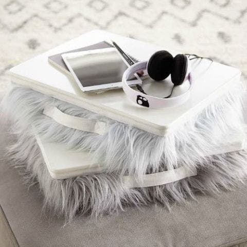 Feather, Fur, Eyelash, Fashion accessory, Table, Natural material, Ear, Silver,