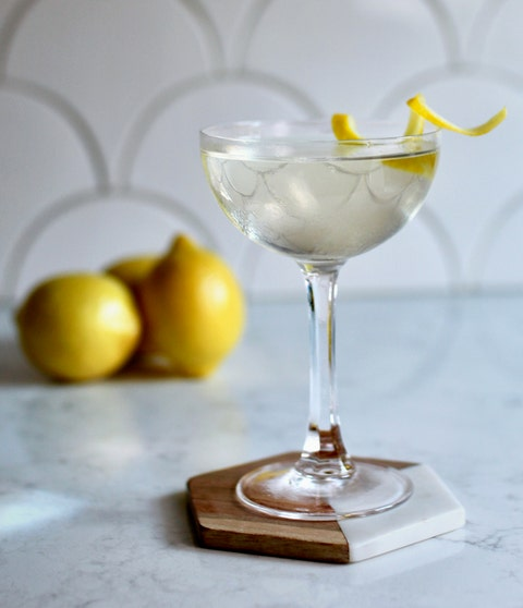 Classic cocktail, Drink, Martini glass, Alcoholic beverage, Cocktail garnish, Corpse reviver, Lemon, Food, Meyer lemon, Distilled beverage,