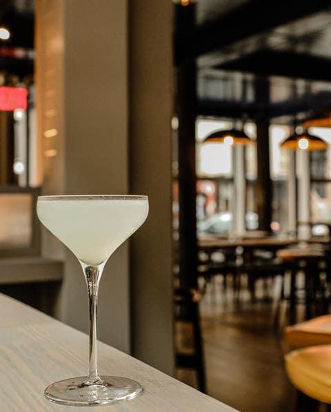 Restaurant, Wine glass, Stemware, Bar, Building, Glass, Room, Drink, Table, Drinkware,