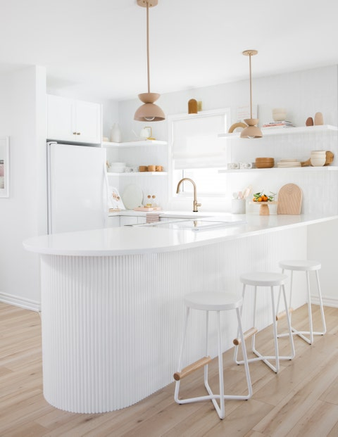 white kitchen with light wood