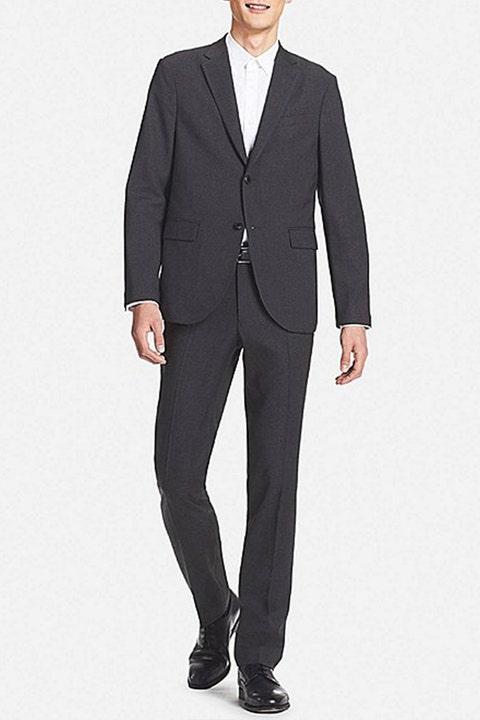 Suit, Clothing, Formal wear, Blazer, Outerwear, Standing, Tuxedo, Suit trousers, Jacket, Pantsuit,