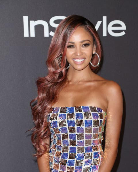 vanessa morgan wears a patchwork sparkly dress on the red carpet