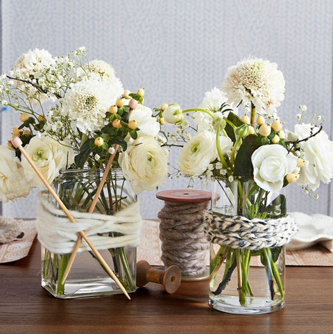 plain glass vases wrapped with strands of yarn