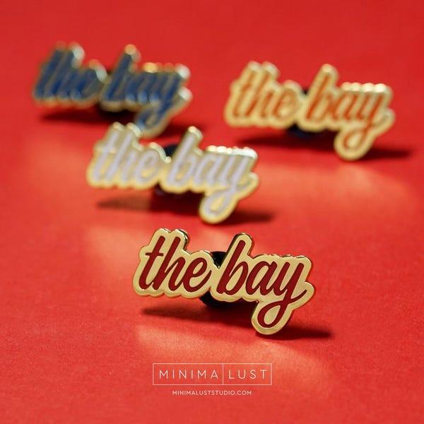 The Bay Red & Gold Enamel Lapel Pin