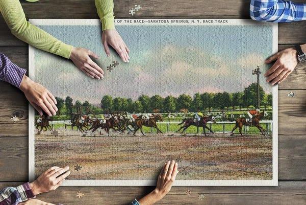 Jockeys Finishing Horse Race at Race Track