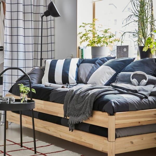 UTÅKER Stackable bed with 2 mattresses - pine/Minnesund Twin